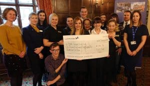 Maids Head staff celebrating our fundraising success for Break